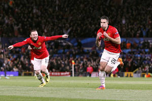 Photo - Manchester United's Robin van Persie, right, celebrates scoring their third goal, and his hat-trick against Olympiakos, with team-mate Wayne Rooney, left, during the UEFA Champions League, Round of 16, second leg match at Old Trafford, Manchester, England, Wednesday March 19, 2014.  (AP Photo / Peter Byrne, PA) UNITED KINGDOM OUT - NO SALES - NO ARCHIVES