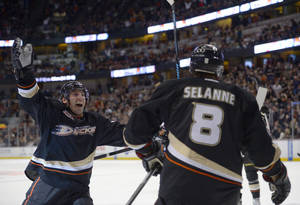 Photo - Anaheim Ducks defenseman Francois Beauchemin, left, congratulates right wing Teemu Selanne, of Finland, after Selanne scored during the second period of an NHL hockey game against the Edmonton Oilers, Sunday, Dec. 15, 2013, in Anaheim, Calif. (AP Photo/Mark J. Terrill)