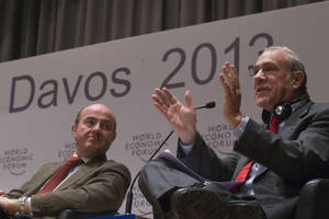 Photo - Secretary-General of the OECD, Angel Gurria, right, gestures as he speaks at the Open Forum, while Spanish Economy Minister, Louis de Guindos Jurado looks on, on the sideline of the 43rd Annual Meeting of the World Economic Forum, WEF, in Davos, Switzerland, Friday, Jan. 25, 2013. (AP Photo/Michel Euler)