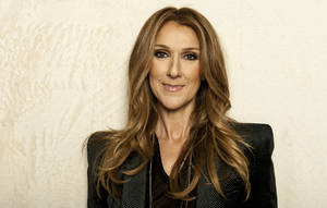 Photo - Singer Celine Dion poses for a portrait on Saturday, Dec. 14, 2012 in Los Angeles. (Photo by Jordan Strauss/Invision/AP)