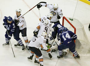 photo - OKC Barons get into a jumble near the Barons' goal as they play the Toronto Marlies during Field Trip Day at the Cox Convention Center in Oklahoma City, OK, Tuesday, Nov. 8, 2011. By Paul Hellstern, The Oklahoman ORG XMIT: KOD
