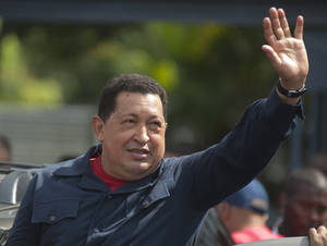 Photo -   Venezuela's President Hugo Chavez waves as he leaves a polling station after voting in the presidential election in Caracas, Venezuela, Sunday, Oct. 7, 2012. Chavez is running for re-election against opposition candidate Henrique Capriles. (AP Photo/Sharon Steinmann)