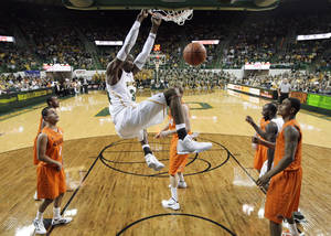 Photo - Baylor forward Cory Jefferson, dunks against Oklahoma State  in the second half of an NCAA college basketball game Saturday, Jan. 14, 2012, in Waco, Texas. Baylor won 106-65. (AP Photo/Tony Gutierrez) ORG XMIT: TXTG109