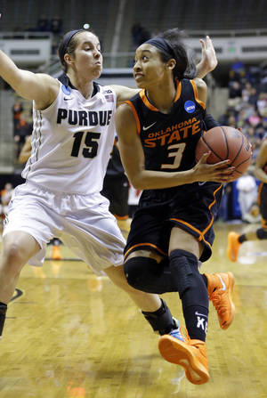 Photo - Oklahoma State guard Tiffany Bias, right, drives on Purdue guard Courtney Moses during the first half of a women's second round NCAA tournament college basketball game in West Lafayette, Ind., Monday, March 24, 2014.  (AP Photo/Michael Conroy)