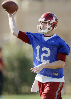 Photo - COLLEGE FOOTBALL: Landry Jones (12) passes during spring football practice for the OU Sooners on the campus of the University of Oklahoma in Norman, Okla., Monday, March 5, 2012. Photo by Nate Billings, The Oklahoman