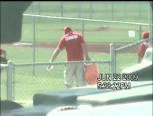 photo - In this screen grab from a private investigator's video, Jonathan Farris Saffa is seen carrying a water bucket at a boys' baseball game. Saffa was charged last year with workers' compensation fraud because of the video. PHOTO PROVIDED