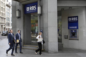 Photo - FILE - In this Friday, Aug. 3, 2012 file photo people walk by a branch of Royal Bank of Scotland (RBS) in the City of London. U.S. and U.K. authorities fined the Royal Bank of Scotland more than $610 million Wednesday for its role in the manipulation of a key global interest rate — with the bank pledging to make the rate-riggers and their managers foot the bill.  (AP Photo/Sang Tan, File)