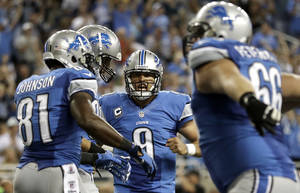 Photo -   Detroit Lions quarterback Matthew Stafford (9) celebrates his 5-yard touchdow pass to Kevin Smith in the fourth quarter of an NFL football game against the St. Louis Rams in Detroit, Sunday, Sept. 9, 2012. Detroit won 27-23. (AP Photo/Paul Sancya)