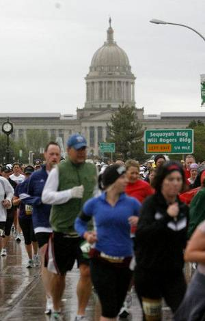 Photo - Runners pass the state Capitol during the 11th annual Oklahoma City Memorial Marathon on Sunday. <strong>SARAH PHIPPS - THE OKLAHOMAN</strong>