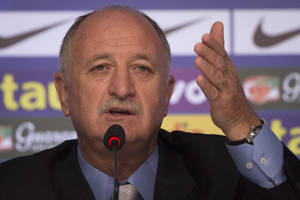 Photo - FILE - This is a Wednesday, May 7, 2014  file photo of Brazil's soccer coach Luiz Felipe Scolari as he announces his list of players for the 2014 Soccer World Cup during a news conference in Rio de Janeiro, Brazil.  Brazil coach Luiz Felipe Scolari is the subject of a criminal investigation in Portugal, authorities said Wednesday May 14, 2014. Officials wouldn't say what the investigation is about. In Portugal, ongoing investigations fall under the country's judicial secrecy law. (AP Photo/Felipe Dana, File)