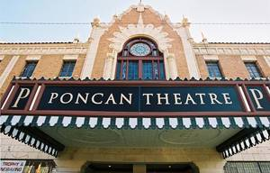 Photo - Ponca City, Okla. - Oct. 5, 2003.     THEATER: Ponca City landmark. Poncan Theatre.    The historic Poncan Theatre on Grand Ave in downtown Ponca City plays host to a number of theatrical productions throughout the year.  The restored  theatre was built in 1927 and is on the National Register of Historic Places.  Staff Photo by Jim Argo