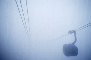 Photo - A gondola goes through the fog prior to the men's snowboard cross competition at the Rosa Khutor Extreme Park, at the 2014 Winter Olympics, Monday, Feb. 17, 2014, in Krasnaya Polyana, Russia. (AP Photo/Andy Wong)