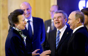 Photo - International Olympic Committee member Princess Anne of Great Britain, left, greets Russian President Vladimir Putin, right, IOC President Thomas Bach, second from right, and Sochi 2014 Olympics President Dmitry Chernyshenko, left, at an event welcoming IOC members ahead of the upcoming 2014 Winter Olympics at the Rus Hotel, Tuesday, Feb. 4, 2014, in Sochi, Russia. (AP Photo/David Goldman, Pool)