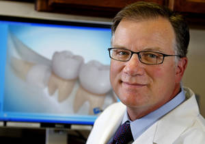 Photo - Dr. Scott Searcey is an oral and maxillofacial surgeon in Oklahoma City. He regularly performs wisdom tooth extraction.  Photo by Bryan Terry, The Oklahoman