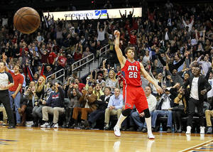 Photo - Atlanta Hawks shooting guard Kyle Korver (26) reacts after sinking a 3-pointer late in the fourth period during an NBA basketball game against the Miami Heat in Atlanta, Monday, Jan. 20, 2014. The Hawks won the game 121-114. (AP Photo/Todd Kirkland)