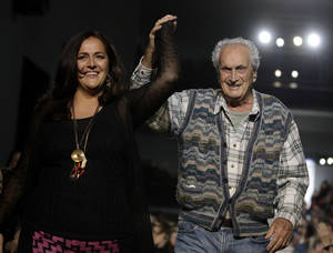 Photo - FILE -  In this Feb. 27, 2011 file photo Ottavio Missoni, right, and his daughter Angela acknowledge the applause of the audience after presenting their Missoni Fall/Winter 2011 collection, in Milan, Italy. Italian fashion company Missoni says its co-founder, Ottavio Missoni, has died in his home earlier on Thursday, May 9, 2013 in northern Italy. Missoni, who was 92, founded the iconic fashion brand of zigzagged-patterned knitwear along with his wife, Rosita, in 1953. The Missonis are a family fashion dynasty, with the couple's children and their offspring involved in expanding the brand. (AP Photo/Luca Bruno, File)