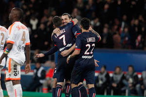 Photo - Paris Saint Germain's Zlatan Ibrahimovic, center, celebrates with teammates after scoring a goal, during their French League one soccer match against Valenciennes, at the Parc des Princes stadium, in Paris, Friday, Feb. 14, 2014. (AP Photo/Thibault Camus)