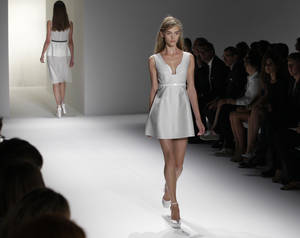 Photo -   Models wear designs from the Calvin Klein Spring 2013 collection at Fashion Week in New York, Thursday, Sept. 13, 2012. (AP Photo/Kathy Willens)