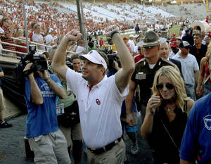 Photo - OU coach Bob Stoops celebrates after the Red River Rivalry college football game between the University of Oklahoma Sooners (OU) and the University of Texas Longhorns (UT) at the Cotton Bowl on Saturday, Oct. 2, 2010, in Dallas, Texas. OU defeated Texas 28-20.  Photo by Bryan Terry, The Oklahoman