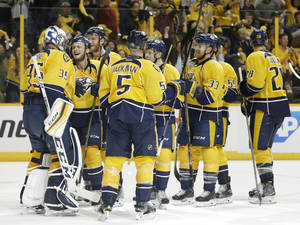 Nashville Predators players congratulate goalie Pekka Rinne (35), of Finland, after beating the San Jose Sharks 4-1 in Game 3 of an NHL hockey Stanley Cup Western Conference semifinal playoff series Tuesday, May 3, 2016, in Nashville, Tenn. The Sharks lead the series 2-1. (AP Photo/Mark Humphrey)