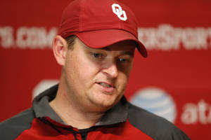 Photo - University of Oklahoma co-offensive coordinator Josh Heupel talks after an OU college football practice in Norman, Okla., Tuesday, August 7, 2013.  Photo by Bryan Terry, The Oklahoman