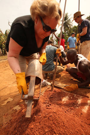 Photo - Gospel recording artist Sandi Patty pitches in during the drilling process by helping clean the auger during a recent mission trip with the Oklahoma City-based Water4 nonprofit organization.
