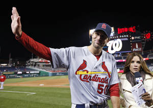 Photo - St. Louis Cardinals starting pitcher Adam Wainwright waves to fans before doing a media interview after a baseball game against the Washington Nationals at Nationals Park on Thursday, April 17, 2014, in Washington. Wainwright pitched a two-hitter as St. Louis won 8-0. (AP Photo/Alex Brandon)