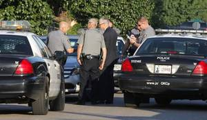 Photo - Oklahoma City police investigate a shooting in the 1800 block of NW 9 Street in Oklahoma City Wednesday, June 11, 2014. The shooting was reported as a possible robbery attempt. Photo by Paul B. Southerland, The Oklahoman