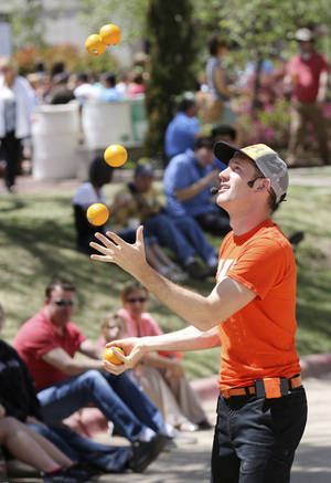 "Photo - ""Wacky Chad"" juggles oranges during his performance at the 2014 Festival of the Arts   in Oklahoma City, Friday April 25, 2014. Photo By Steve Gooch, The Oklahoman"