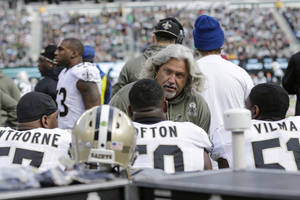 Photo - In this Nov. 3, 2013, photo, New Orleans Saints defensive coordinator Rob Ryan talks to his team during the first half of an NFL football game against the New York Jets in East Rutherford, N.J.  In his first season with New Orleans, Ryan has perhaps done his best work yet, keeping a unit beset by key injuries performing well into the divisional round of the playoffs. Now, however, the Saints' defense returns to Seattle, site of its worst performance this season. (AP Photo/Mel Evans)