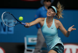 Photo - Maria Sharapova of Russia hits a forehand return to Alize Cornet of France during their third round match at the Australian Open tennis championship in Melbourne, Australia, Saturday, Jan. 18, 2014.(AP Photo/Aaron Favila)