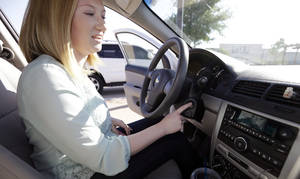 Photo -  Wendi Kunkel points out the key in the ignition on her 2010 Chevy Cobalt in Rockwall, Texas. Although she was instructed by her dealer to pull everything off her keychain — which GM contends will stop the ignition switches from turning off unexpectedly — she's still nervous about driving her car on her 30-minute one-way commute. AP Photo  <strong>LM Otero -  AP </strong>