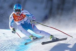 Photo - Austria's Matthias Mayer makes a turn in a men's downhill training run for the Sochi  2014 Winter Olympics, Friday, Feb. 7, 2014, in Krasnaya Polyana, Russia. (AP Photo/Alessandro Trovati)