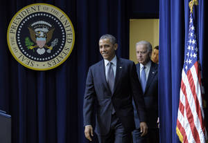 photo - President Barack Obama, followed by Vice President  Joe Biden, arrives in the South Court Auditorium at the White House in Washington, Wednesday, Jan. 16, 2013, to talk about proposals to reduce gun violence.  (AP Photo/Susan Walsh)