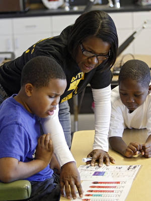 Photo - Johnson Elementary teacher Cynthia Johnson works with kids in her classroom. Photo by Steve Gooch, The Oklahoman <strong>CHRIS LANDSBERGER - CHRIS LANDSBERGER</strong>