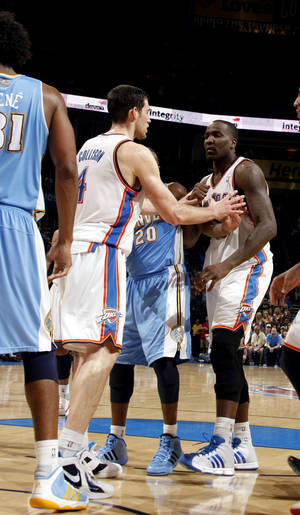 Photo - Oklahoma City's Nick Collison (4) holds back Kendrick Perkins (5) after a push from Denver's Nen