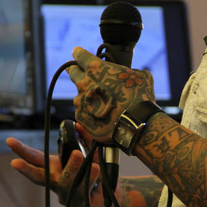 Photo - Joshua Coburn's hands bear tattoos and implants. PHOTO PROVIDED <strong>Picasa</strong>
