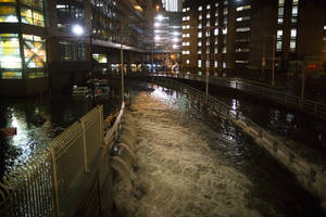 Photo - FILE - In this Oct. 29, 2012 file photo, sea water floods the entrance to the Brooklyn Battery Tunnel in New York during Superstorm Sandy.  A commission formed to examine ways to guard against storms like Sandy released a report Friday that calls for flood walls in subways, water pumps at airports and sea barriers along the coast. The final report was first obtained Tuesday, Jan. 8, 2013 by The Associated Press. The findings were officially released Friday, Jan. 11, 2013, by the office of Gov. Andrew Cuomo, who formed the commission.  (AP Photo/ John Minchillo, File)