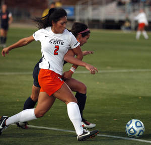 Photo - Oklahoma State's Krista Lopez battles for the ball with Illinois' Christina Farrell during an NCAA college soccer game in Stillwater, Okla., Friday, Nov. 18, 2011. (AP Photo/The Oklahoman, Sarah Phipps)   ORG XMIT: OKOKL301
