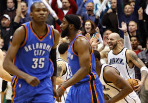 Photo - Thunder forward Kevin Durant, left, walks off the court after missing a last second shot in overtime. Utah beat OKC, 140-139. AP PHOTO