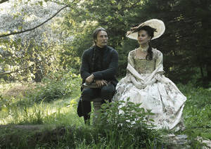 "Photo - This film image released by Magnolia Pictures shows Mads Mikkelsen, left, and Alicia Vikander in a scene from ""A Royal Affair."" The film was nominated for an Academy Award for best foreign picture on Thursday, Jan. 10, 2013.  The 85th Academy Awards will air live on Sunday, Feb. 24, 2013 on ABC. (AP Photo/Magnolia Pictures) ORG XMIT: NYET464"