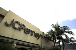 Photo - This Monday, Aug. 19, 2013 photo shows the entrance to a J.C. Penney store at a Hialeah, Fla., shopping mall. On Tuesday, Aug. 20, 2013, J.C. Penney reports quarterly financial results. (AP Photo/J Pat Carter)