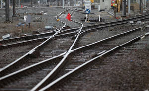 photo -   A red flag blocks the tracks at the main train station in Ghent, western Belgium, Wednesday, Oct. 3, 2012. A 24-hour strike by Belgian rail workers on Wednesday paralyzed train traffic throughout Belgium and the international high-speed service to London and Paris. The strike, which started late Tuesday, reached its peak during the Wednesday morning rush hour when tens of thousands of commuters had to take to traffic-choked highways to get into the capital or work. (AP Photo/Yves Logghe)