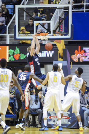Photo - Gonzaga's Przemek Karnowski (24) dunks during the second half of an NCAA college basketball game against West Virginia, Tuesday, Dec. 10, 2013, in Morgantown, W.Va. Gonzaga won 80-76. (AP Photo/Andrew Ferguson)