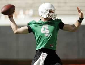 Photo - J.W. Walsh (4) passes during OSU spring football practice at Boone Pickens Stadium on the campus of Oklahoma State University in Stillwater, Okla., Monday, March 12, 2012. Photo by Nate Billings, The Oklahoman