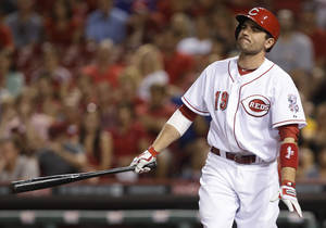 Photo - Cincinnati Reds' Joey Votto strikes out against Milwaukee Brewers relief pitcher Jim Henderson to end a baseball game, Friday, Aug. 23, 2013, in Cincinnati. Milwaukee won 6-4. (AP Photo/Al Behrman)