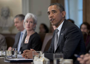 Photo - President Barack Obama speaks to the media before meeting his Cabinet meeting, Tuesday, Jan. 14, 2014, in the Cabinet Room of the White House in Washington. From left are, Education Secretary Arne Duncan, and Health and Human Services Secretary Kathleen Sebelius.  (AP Photo/Carolyn Kaster)
