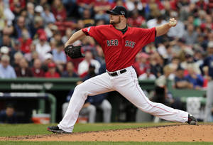 Photo - Boston Red Sox starting pitcher Jon Lester delivers against the Tampa Bay Rays in the third inning in Game 1 of baseball's American League division series on Friday, Oct. 4, 2013, in Boston. (AP Photo/Charles Krupa)