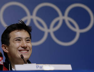 Photo - Silver medalist figure skater Patrick Chan, of Canada, speaks at a news conference at the 2014 Winter Olympics, Saturday, Feb. 15, 2014, in Sochi, Russia. (AP Photo/Morry Gash)