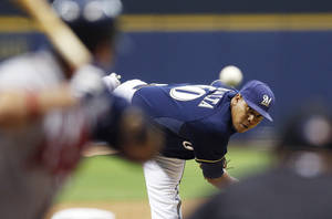 Photo -   Milwaukee Brewers' Wily Peralta pitches to an Atlanta Braves batter during the first inning of a baseball game Monday, Sept. 10, 2012, in Milwaukee. (AP Photo/Tom Lynn)